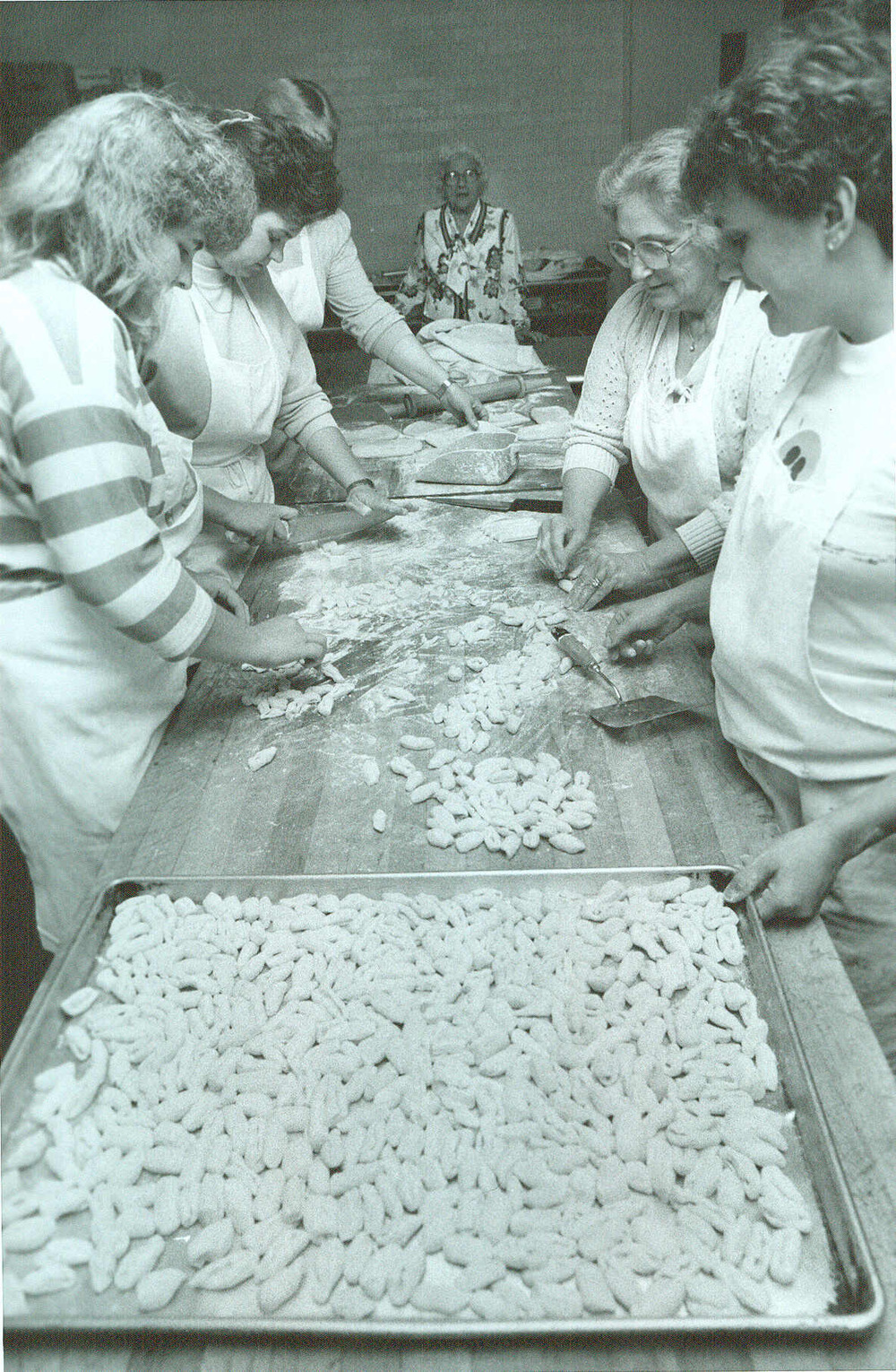 carbone's employees hand rolling gnocchi in 1976.jpg