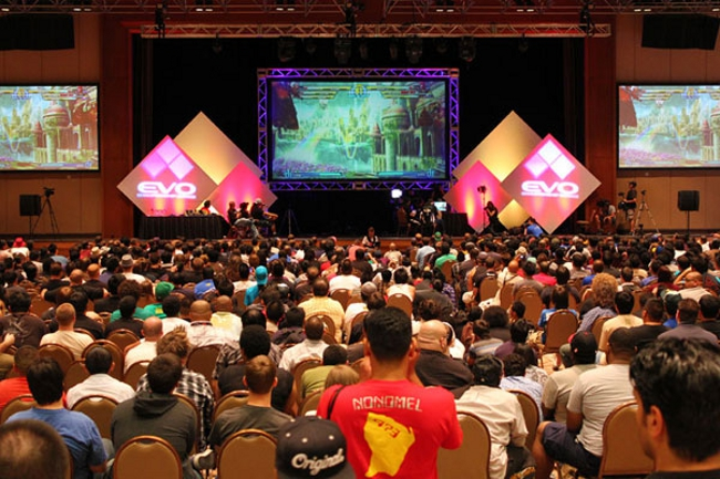 Thousands of fans watch two of the top players compete in a match of  Marvel vs Capcom 3  at Evo 2011