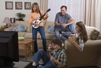 An all too familiar scene, this family is forced to watch their mum play  Guitar Hero III  alone.