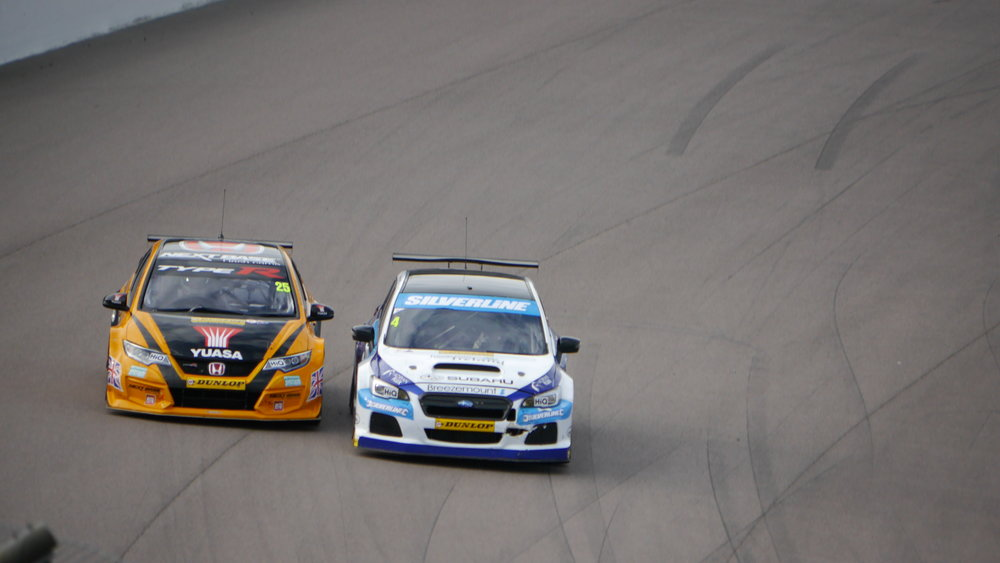 Colin Turkington passes Matt Neal for third place in race 3