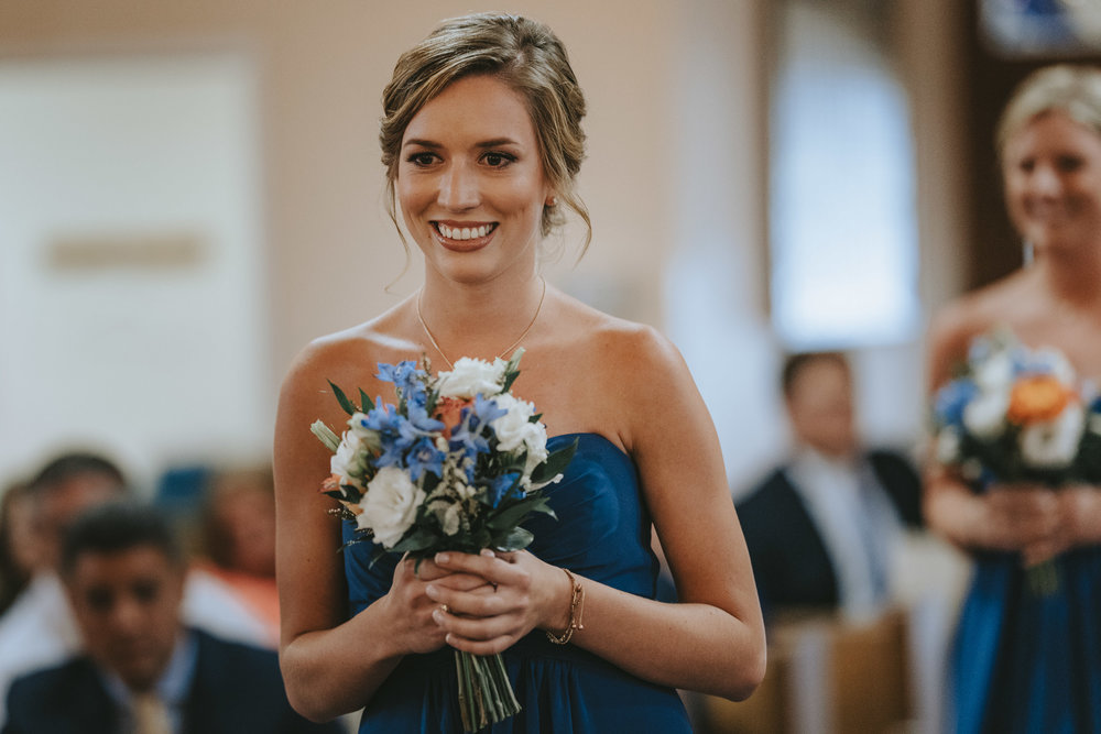 5D MarkIV - 1/250 - ISO1600 - f/1.8 (Nailed focus on bridesmaids walking down the aisle wide open)
