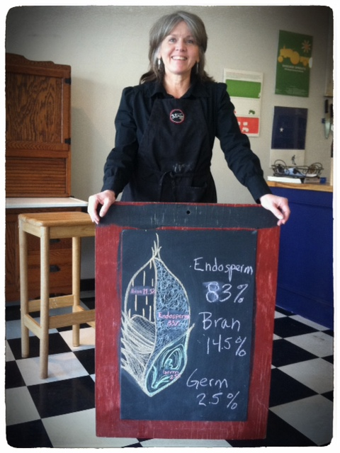 Maureen Joyner of Mimi's Whole Grains holds a drawing of wheat.