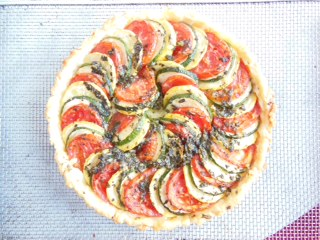 -polenta cheese tart with squash, roma tomato and basil  at Little House Green Grocery's Sunday Supper
