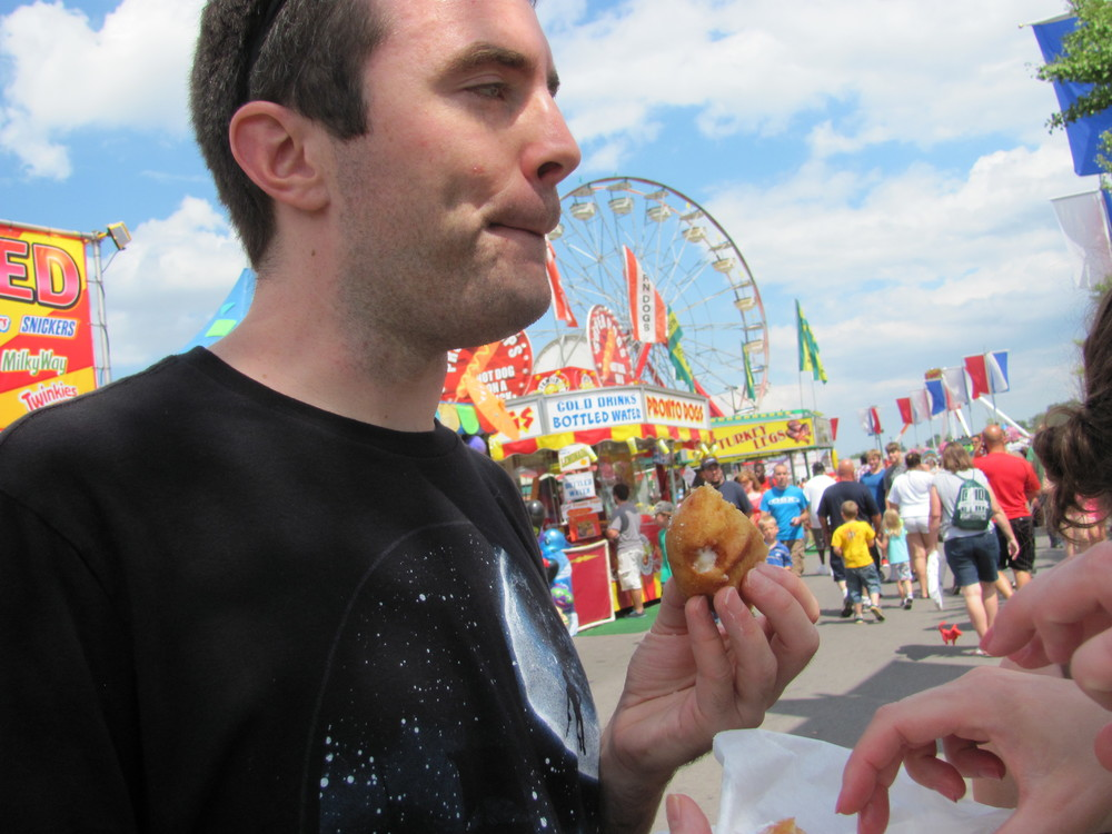 Matt doesn't quite know what to do with himself now that pure evil's touched his lips.  I am referring, of course, to the fried Twinkie.