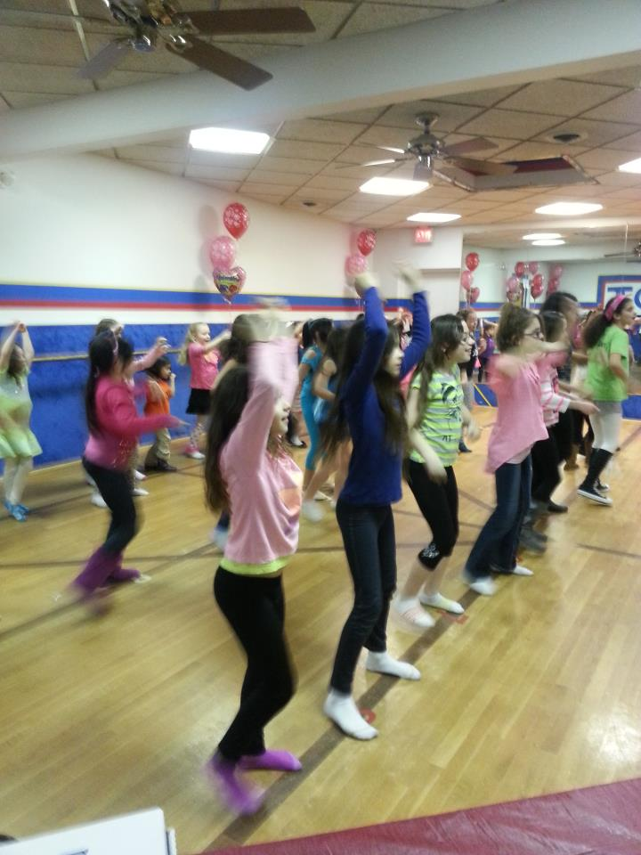 "Everyone doing ""The Cupid Shuffle"" after pizza."