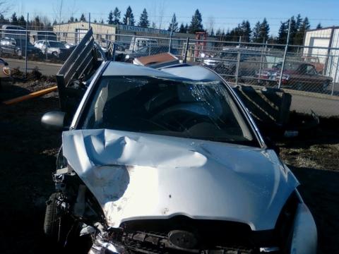 smashed car at junk yard