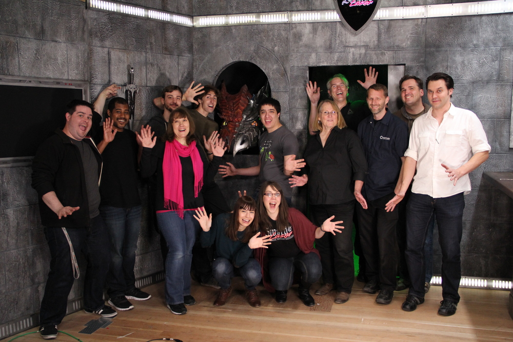 The S&L studio team does jazz hands.