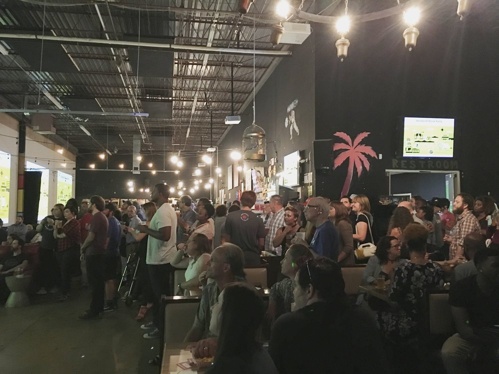 The crowd listens as Indie Memphis Executive Director Ryan Watt previews this year's festival at the Indie Memphis Preview Party, Sept. 26, 2017.