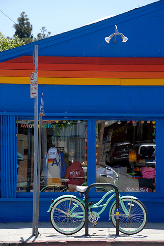 Hip bike in front of a hip store on the coolest block in America.