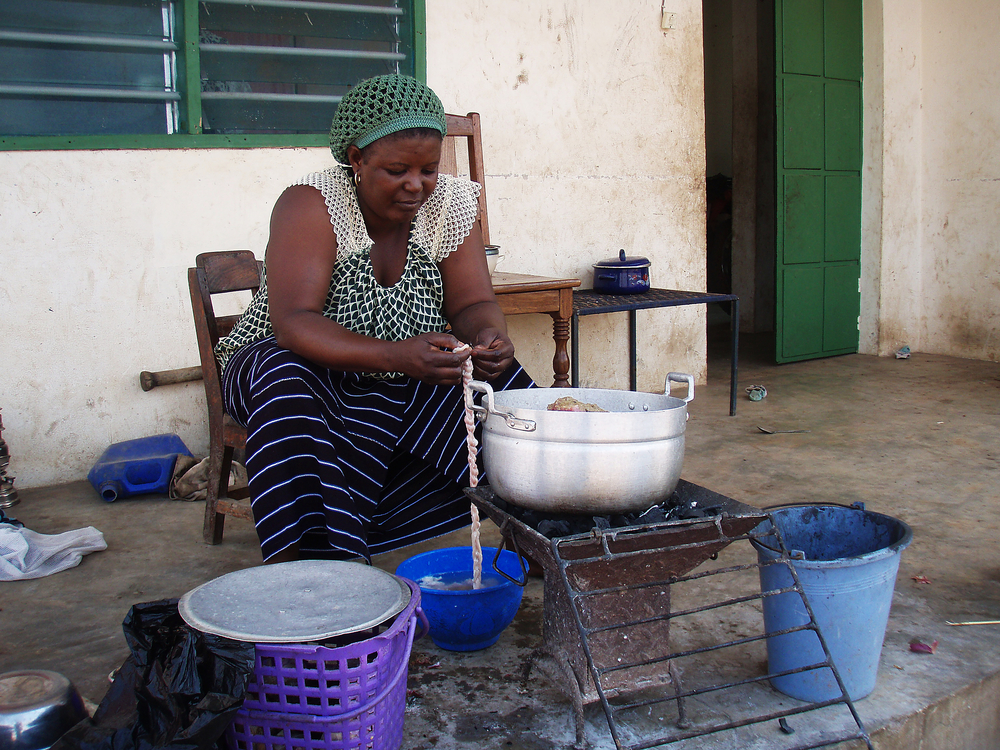 "Falilah, one of the village nurse's two wives, makes sausage from a sheep's intestines. On Tabaski, or Eid al-Adha (or the ""Festival of Sheep"" in Togo), families slaughter a sheep to commemorate Abraham's willingness to sacrifice his son Isaac to God. God instead provided a ram for the sacrifice."