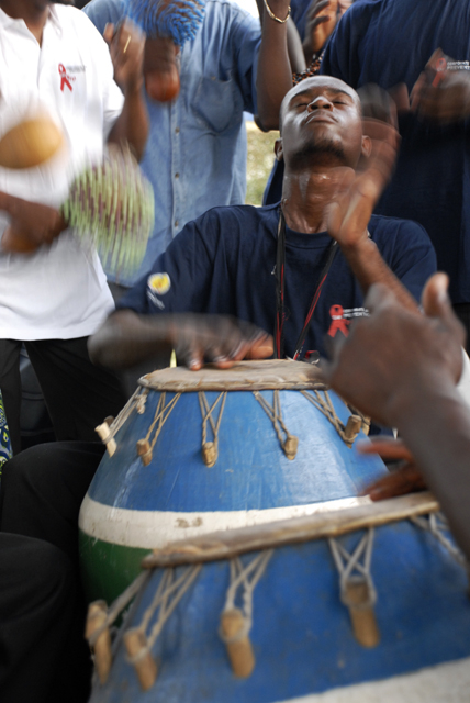 A drummer entertains participants of a health presentation in Lomé, Togo.