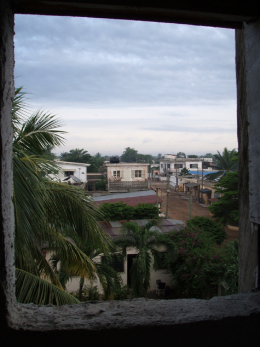 View out the window of a bathroom at Mammy's hostel in Lome, Togo