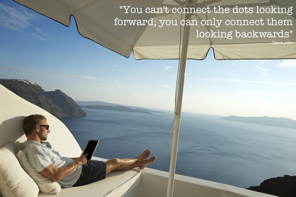Man using tablet overlooking ocean.jpg