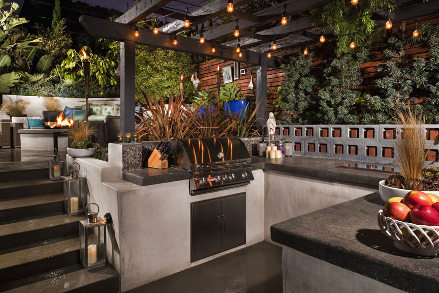 Outdoor Entertaining and Cook Center  - This space needed to be designed for everyday use; and had to be large enough to accommodate a gathering of friends.  The plant material was used to provide a contrast in color and texture and offer accents to the space.  The overhead structure, lighting, and decor set the ambiance and the fire pit above provides warmth from the cool coastal breezes.