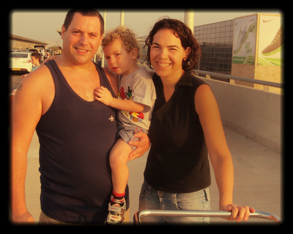 Us (my wife Tal and me, Roy) with Aviv, our middle child. Before entring the airport
