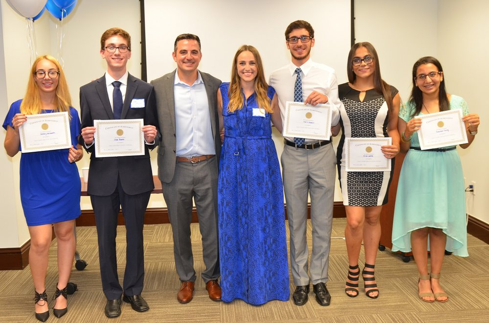 Michael-and-sister-with-Scholarship-Recipients.jpg