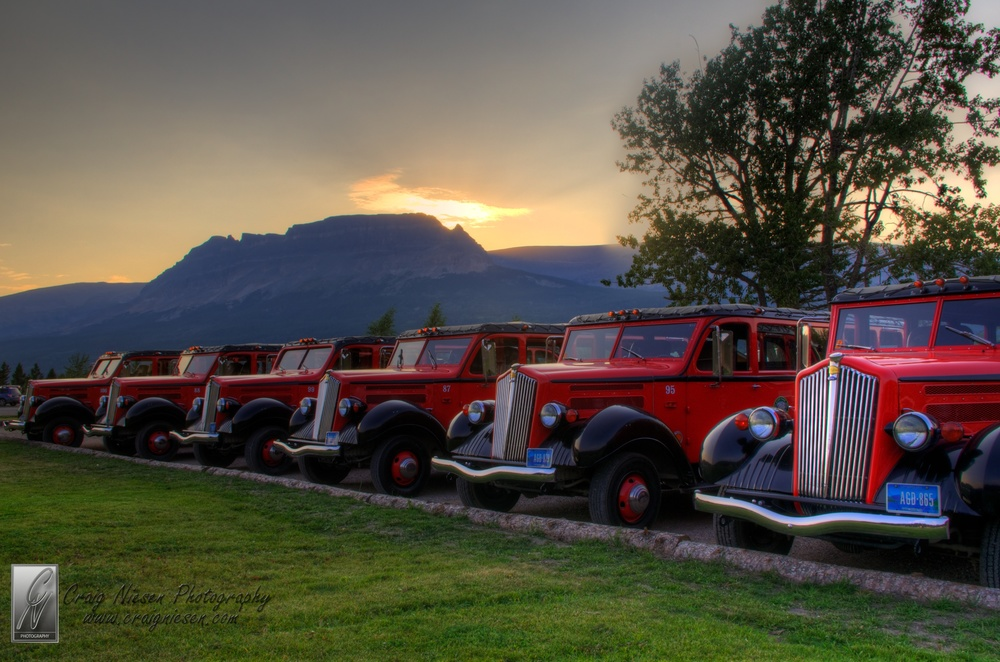 Red Jammers in a Line, Glacier National Park