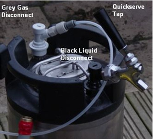 Top of Corny Keg showing grey Co2 disconnect and black liquid-out disconnect and a 'party' tap.