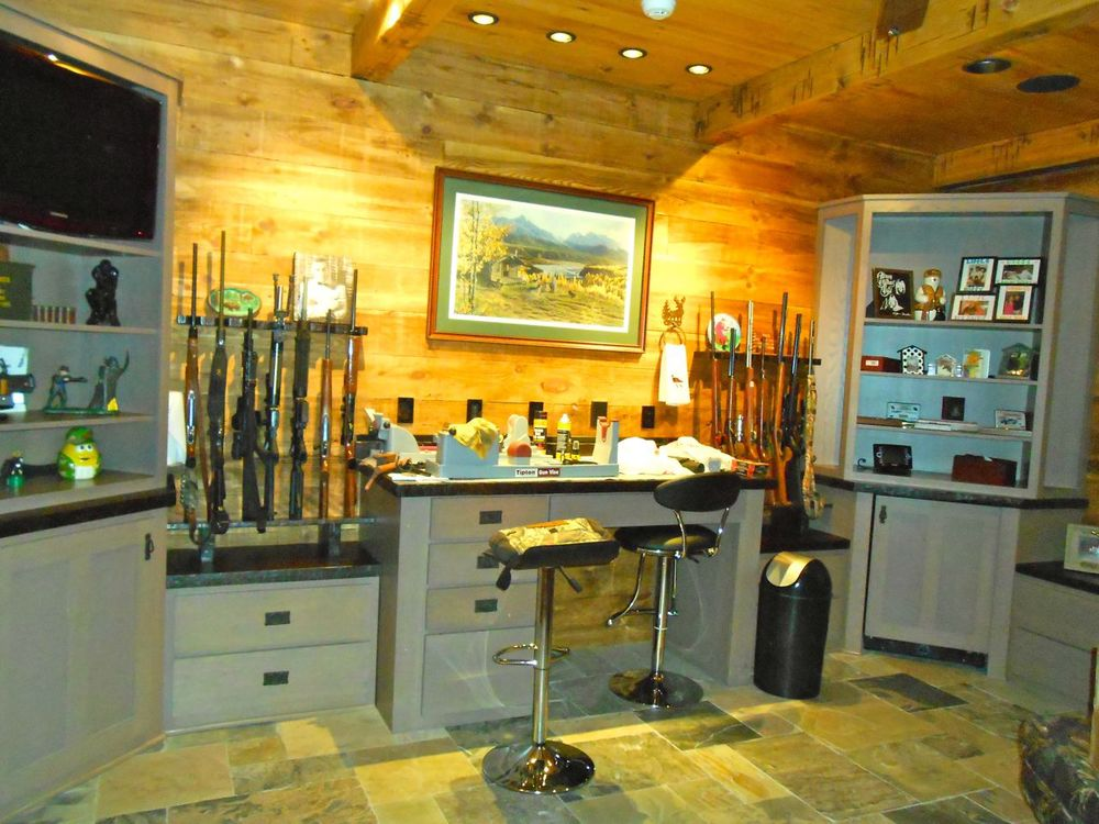 Gun room with extensive bench, facilities and storage.