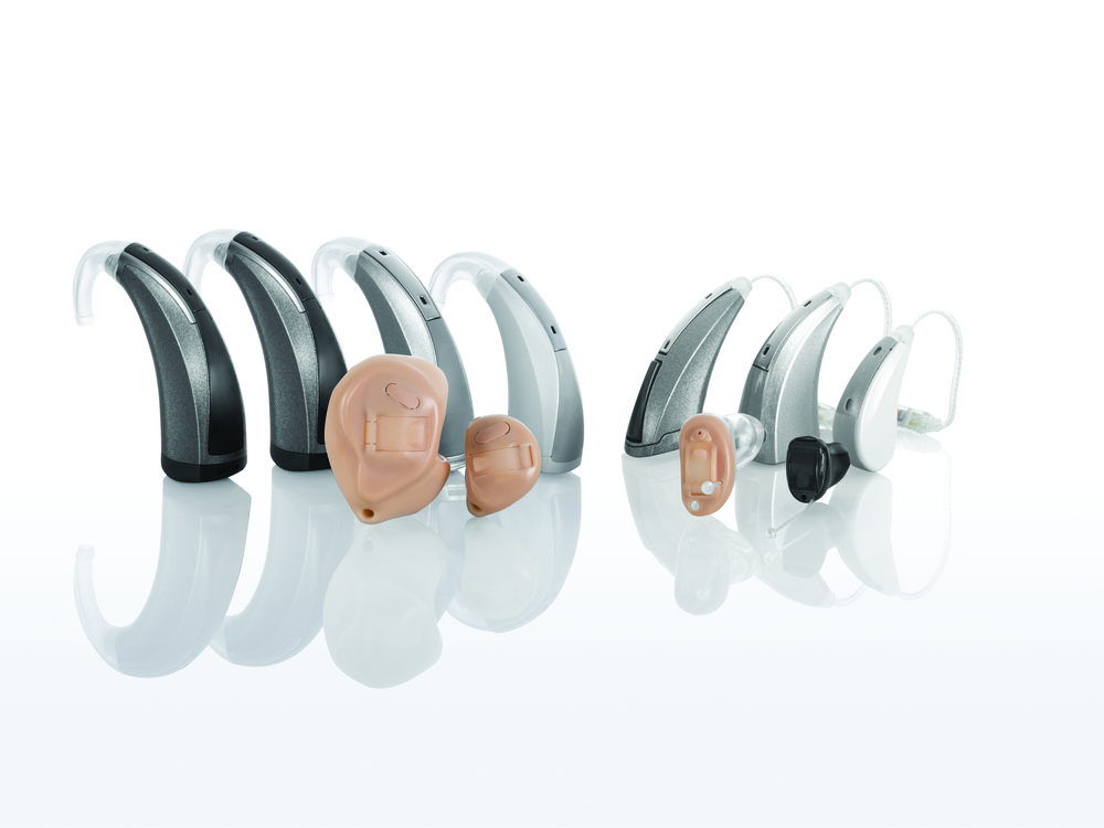 Starkey Hearing Aid family with a  variety of hearing aid styles