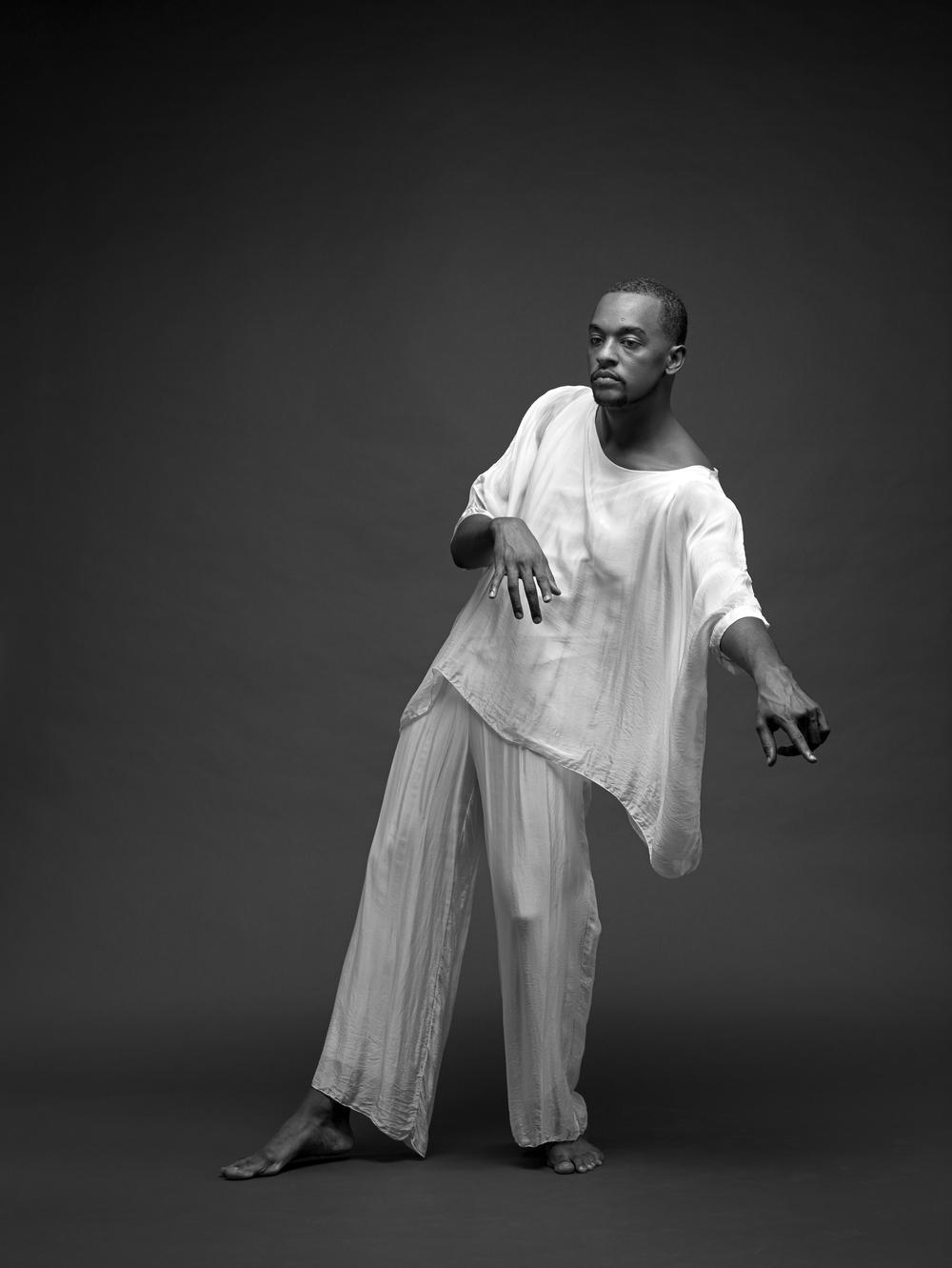 04_Jamal-Dark-Blue-Background-White-Shirt-White-Pants_0277 2.png