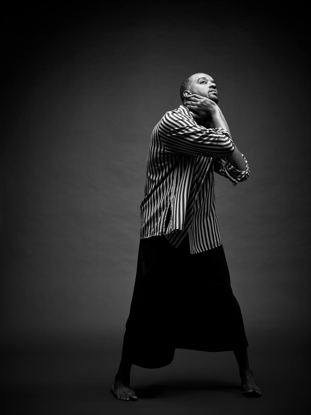 03_Jamal-Dark-Blue-Background-Stripe-Shirt-Black-Pants_0240 1.png