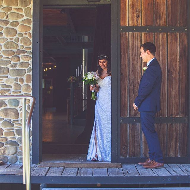 A beautiful little moment split seconds before Priyanka & Matt saw one another on their wedding day. ___  #firstlook #weddingday #narrowslanding #wedinwaikato #waikatowedding #waikatoweddingphotographer #nzbrideandgroom #kiwiwedding #sequindress #nzweddings #doorwaymoments #momentsovermountains #almostmarried #photosfirst #beyourself #celebrateyourway