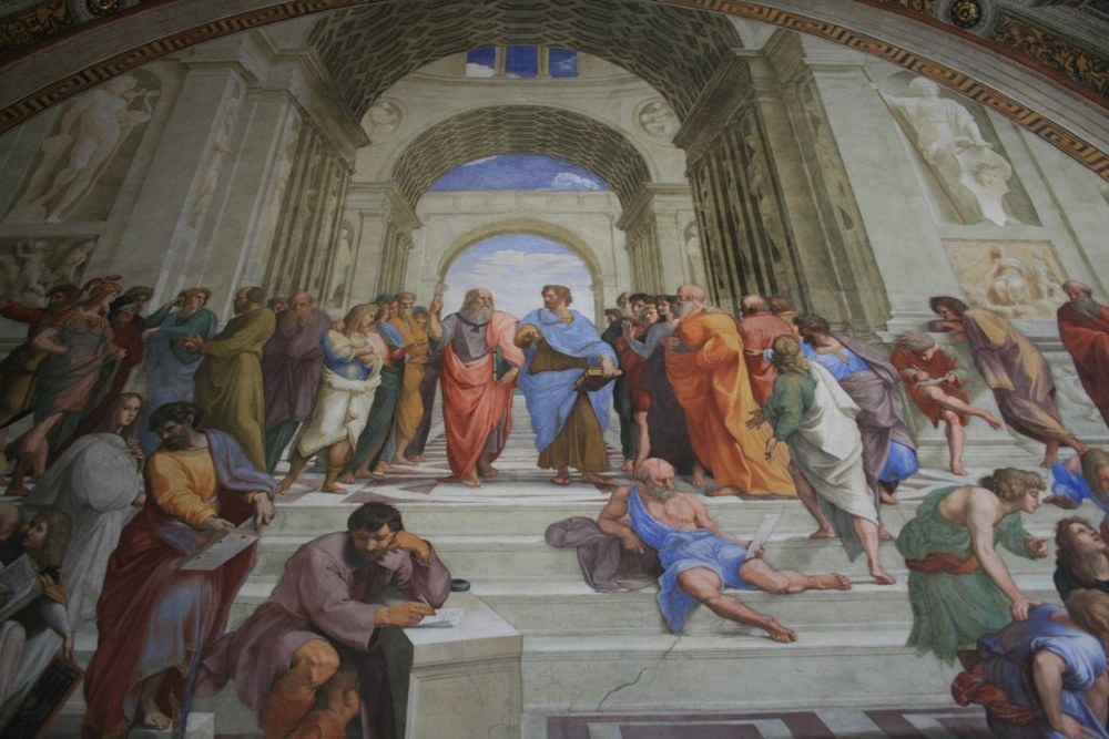 The School of Athens by Raphael. Michelangelo is the melancholy figure in the center with his head on his hand.