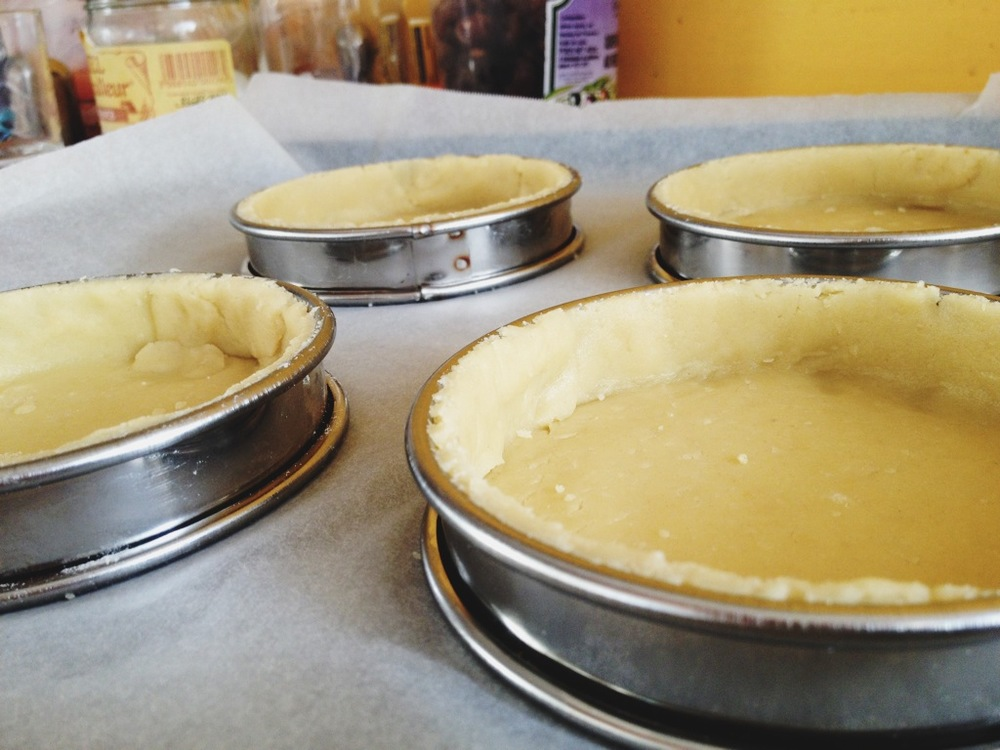 Blind bake the tart shells.