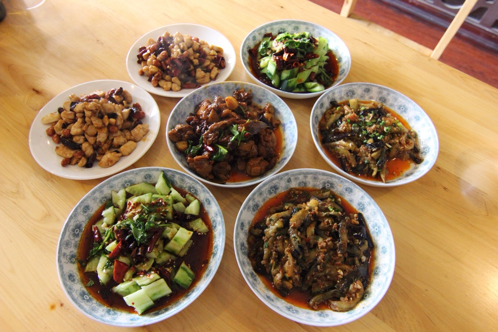 Kung pao chicken, beer duck, cucumber salad and spicy eggplant.