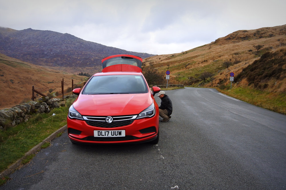 Dad fixing the flat tire we got while passing through Snowdonia National Park