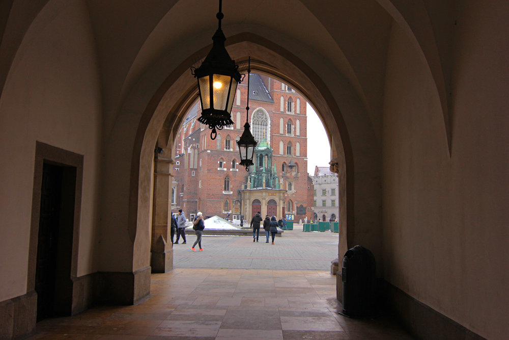 View of Saint Mary's Basilica from the Cloth Hall in Krakow's historical town square.