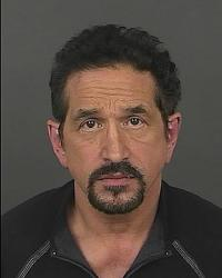 Tom Martino's mugshot after his arrest on a domestic-violence charge