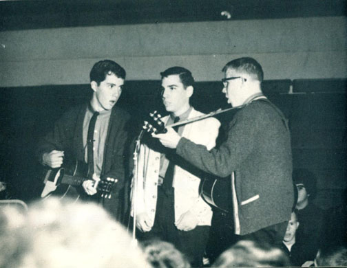 "Founding members of The Tempests (from left): Tim Slevin, Jim Croegaert and Paul Burson sing ""The Lion Sleeps Tonight"" at the Spalding/Academy of Our Lady 1963 hootenanny. ""Wimoweh"" repeated for three minutes sure makes your mouth feel funny."