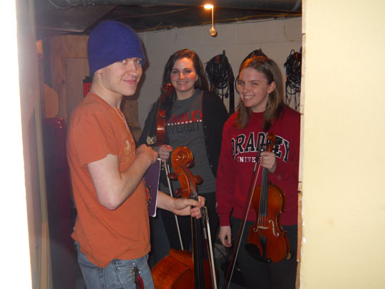 Three members of our Bradley String Quartet, unpacking for a rehearsal this past Thursday in Joel Madigan's studio. Billy Akers, Julie Haring, Lindsay Kozlowski. The fourth will be Jenna Ferdon on first violin.