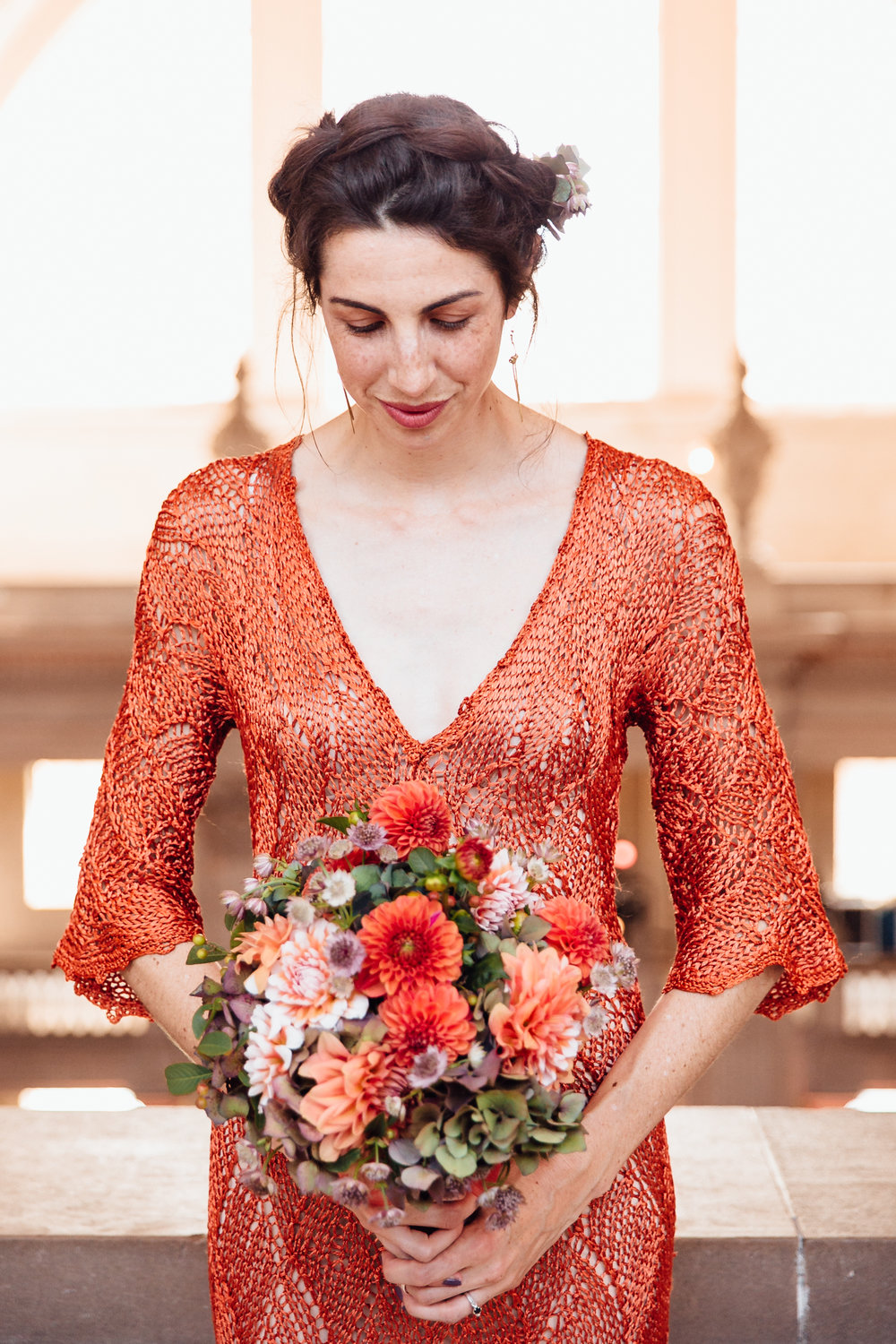 An intimate San Francisco City Hall ceremony, featuring an alternative bride in a bright orange dress.