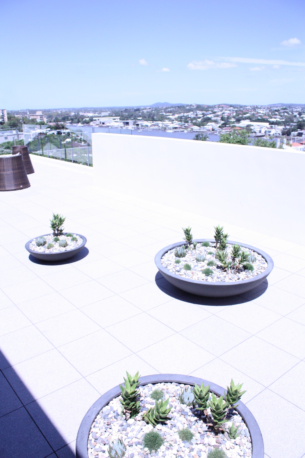 Hamilton, QLD Ultra-modern river-side property with rooftop and courtyard plantings.Read more...