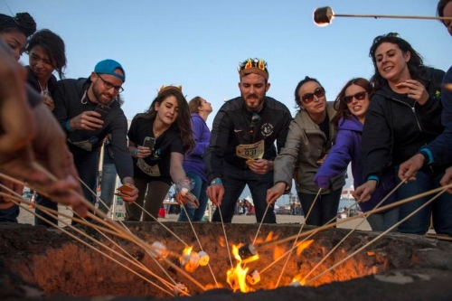 Toasting marshmallows with the neighbours is a great way to get to know each other.