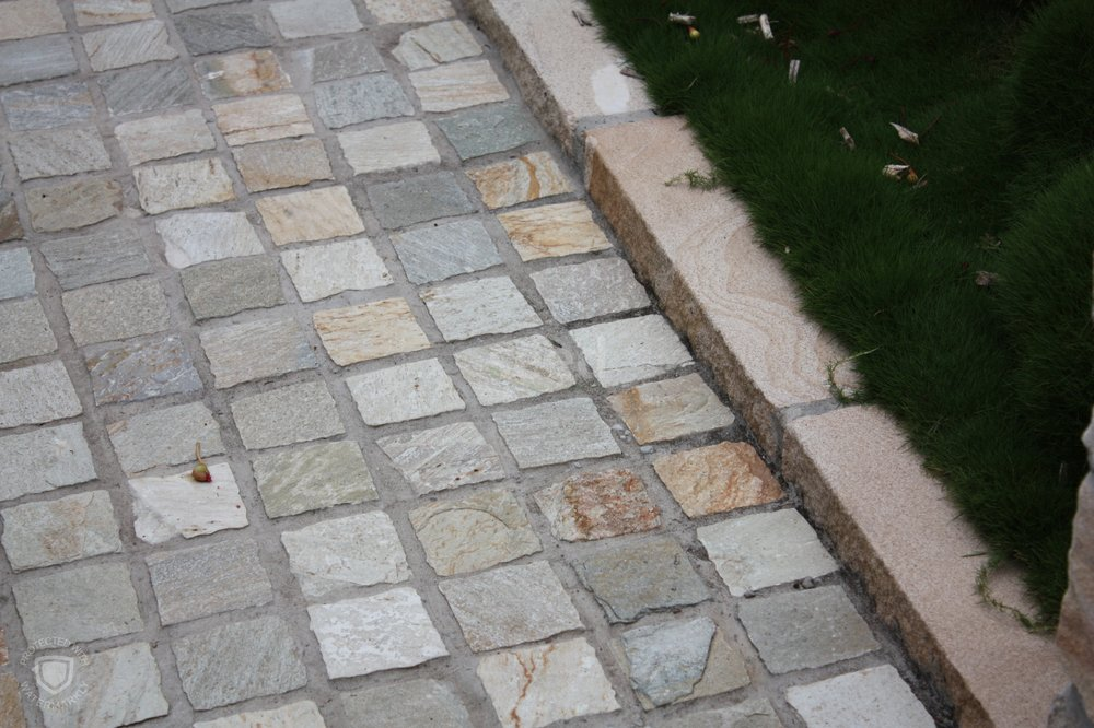 A change in paving design helps distinguish the formal front courtyard, or foyer, from the back garden.