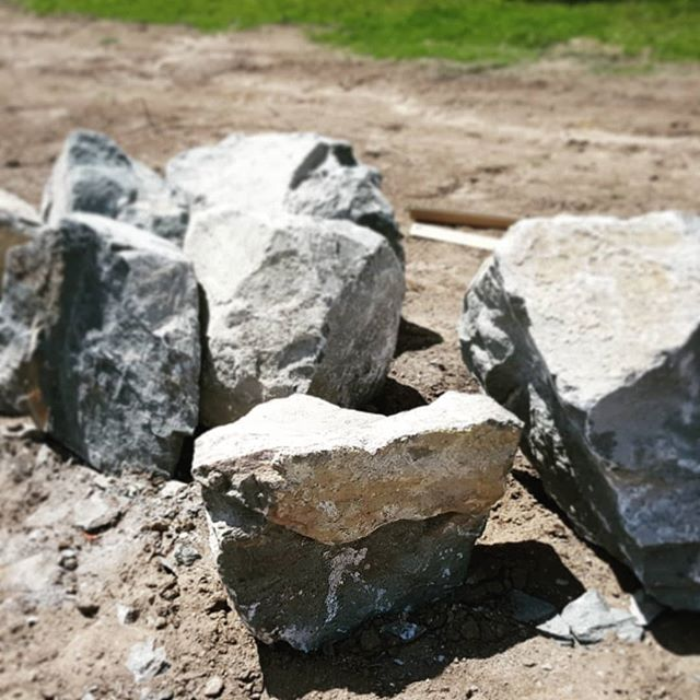 Bluestone boulders ready for the landscape. Impressive features to tie in with pool tiles. #seedlandscapedesign #brisbanelandscapedesign #bluestoneingardens