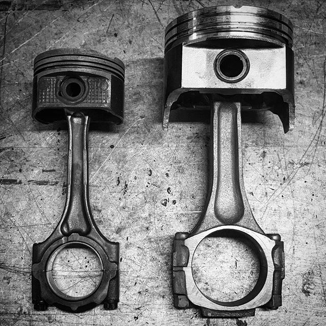 One of four pistons from a 1.8 liter Toyota 1ZZ-FE compared to one of eight pistons from a 7.6 liter big block Chevy