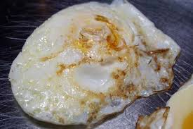 Upside down, runny fried eggs. Yum!