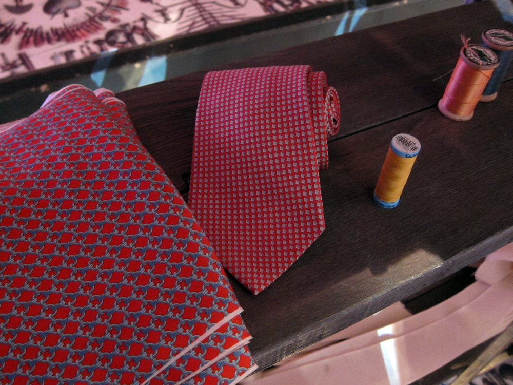 An authentic Hermes tie, silk fabric and the signature orange thread.