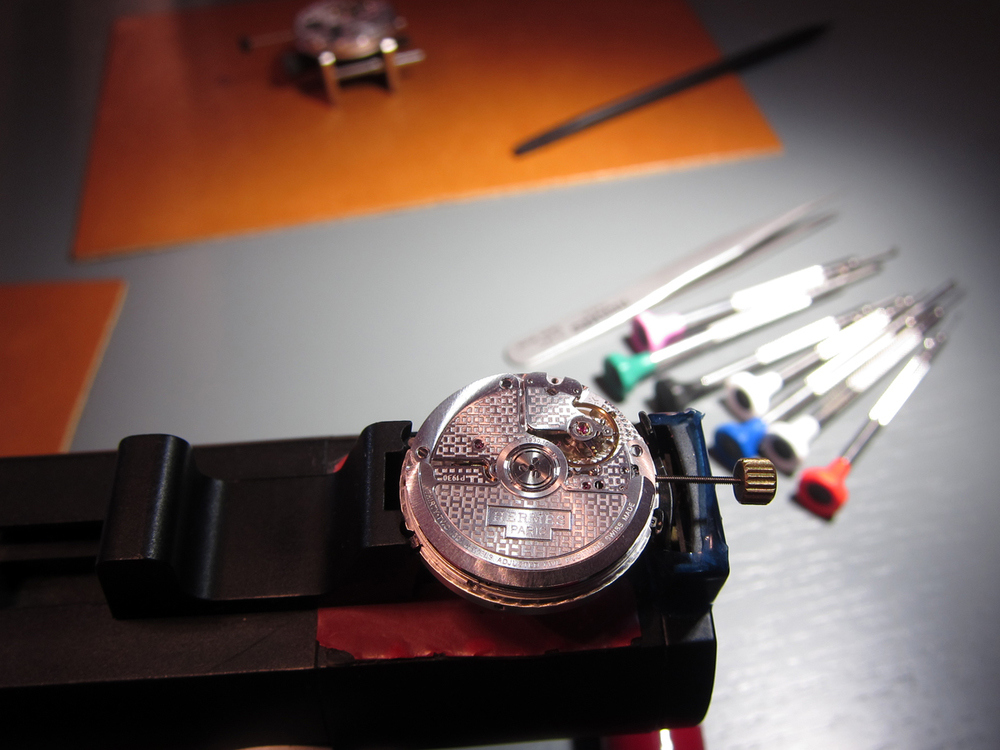 The tiny mechanism that makes up the inners of a watch.