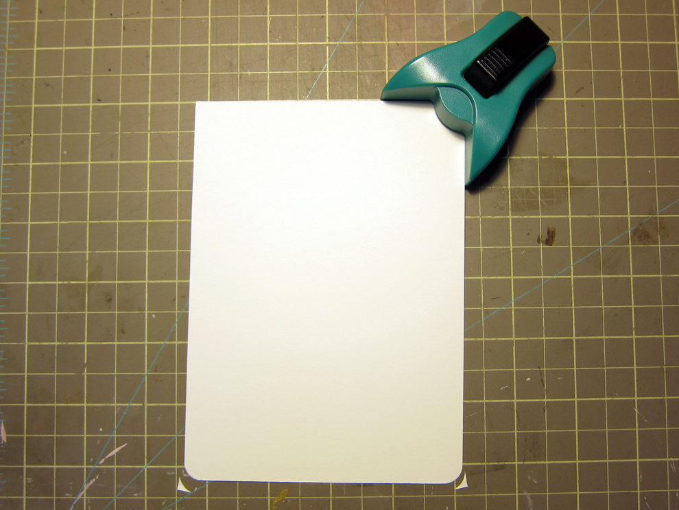 I precut card-stock to fit my envelopes and rounded the corners with a craft punch.