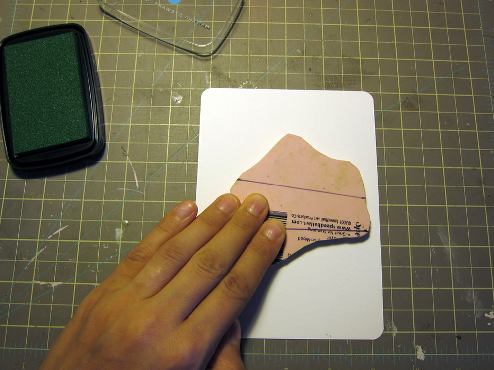 ...then flipped it over, carefully centering the block on the card-stock, and pressed down on the back with my fingertips.