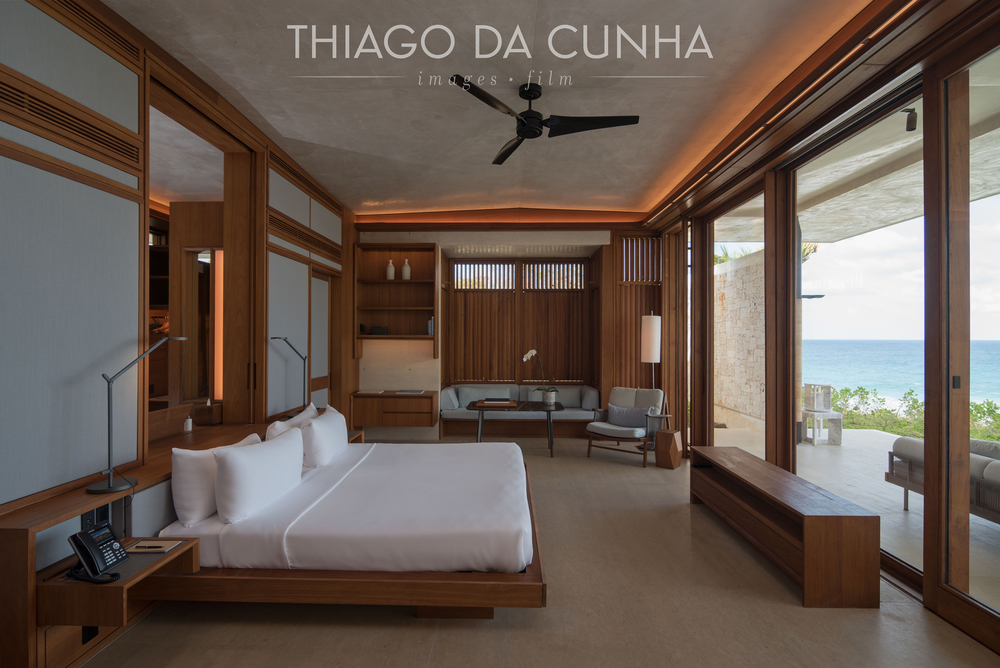With the automatic popup TV hidden in front of the bed, the guest has a beautiful view of the pool and ocean. Automatic blackout curtains give privacy when needed. Wood is a constant through out the villa.