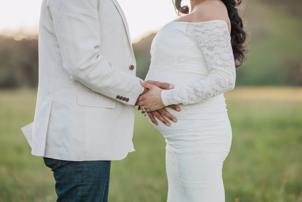 Husband holding wife pregnant belly during maternity session in San Jose, California.