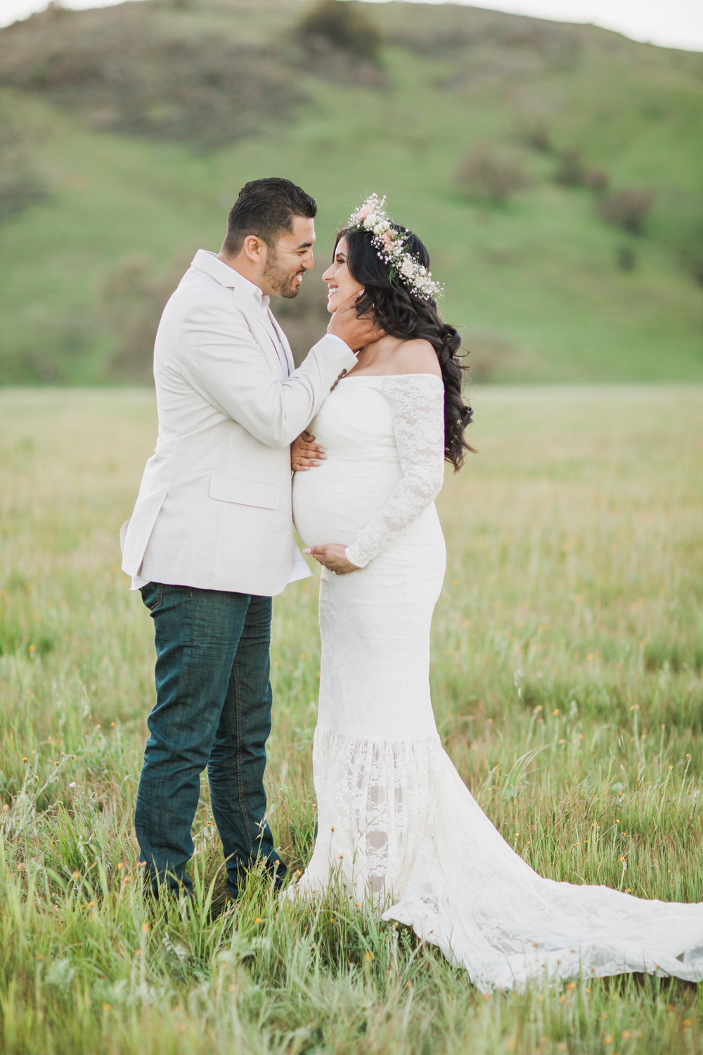 Couple standing in a field during maternity session in San Jose, California.
