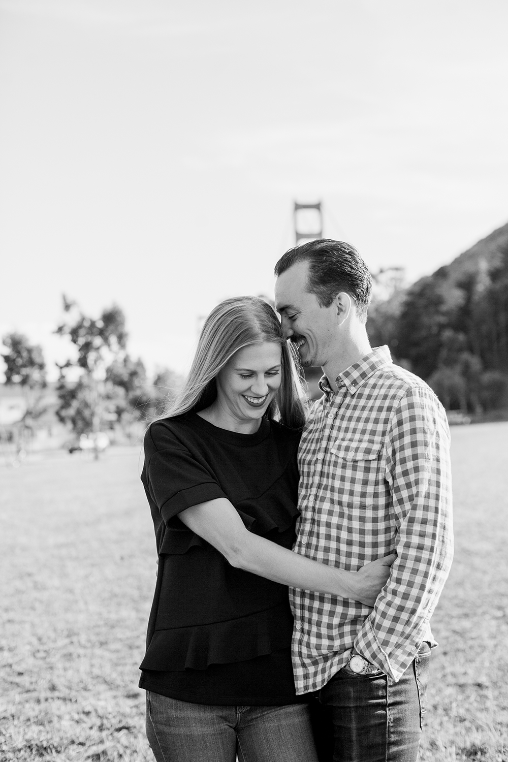 Couple laughing during their engagement session at Cavallo Point in Marin, California.